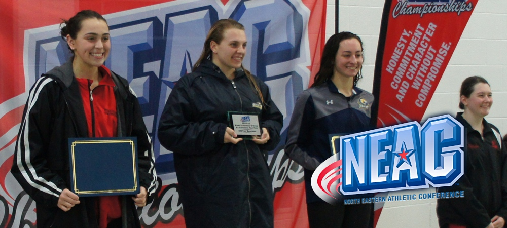 GU women's swimmer Julia Miller-Notestone stands on the podium at the NEAC championship. She won her event. A NEAC logo is in the lower right corner.
