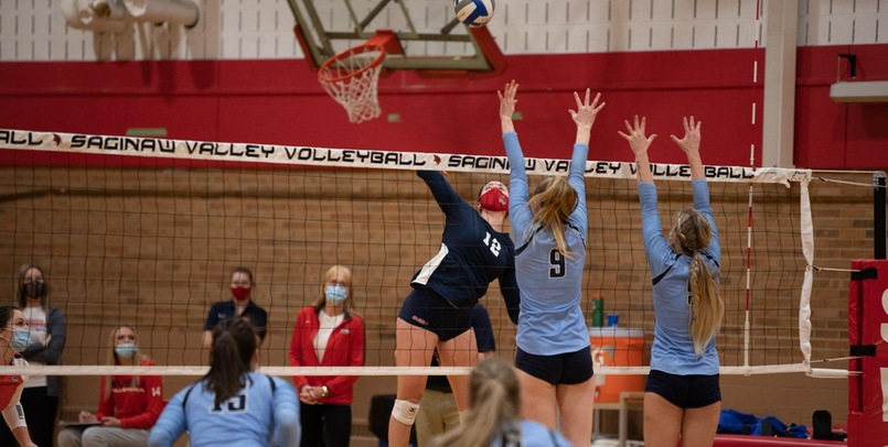 Cardinal Volleyball holds on to top Eagles in four