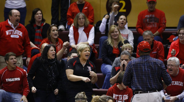Director of Athletics and Recreation Garnett Purnell (blue shirt with back to camera) leads the Wittenberg cheering section during a 3-0 win over Hope. Photo by Paul Evans