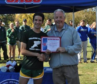 Rob Albano accepts the 2012 CACC Men's Cross-Country Runner of the Year award from conference commissioner Dan Mara. (Courtesy CACC)