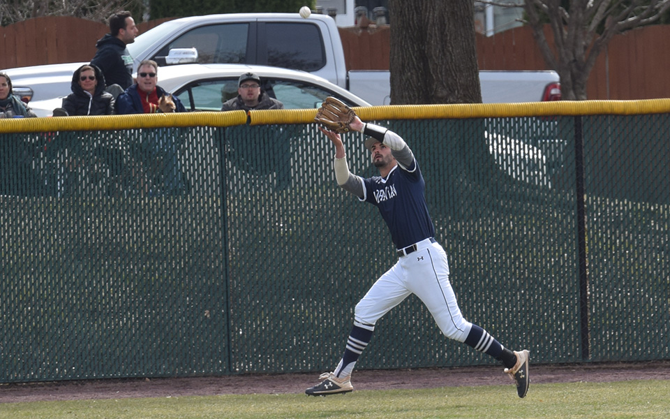 Senior Mike Mittl tracks down a fly ball in left field versus Elizabethtown College at Gillespie Field.