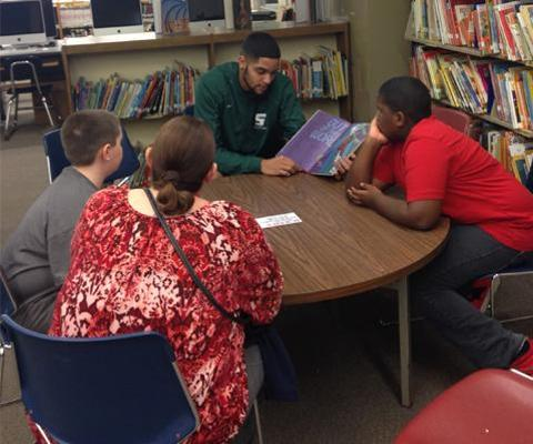 Sage men's basketball participates in Carroll Hill School Hoops and Literacy Program