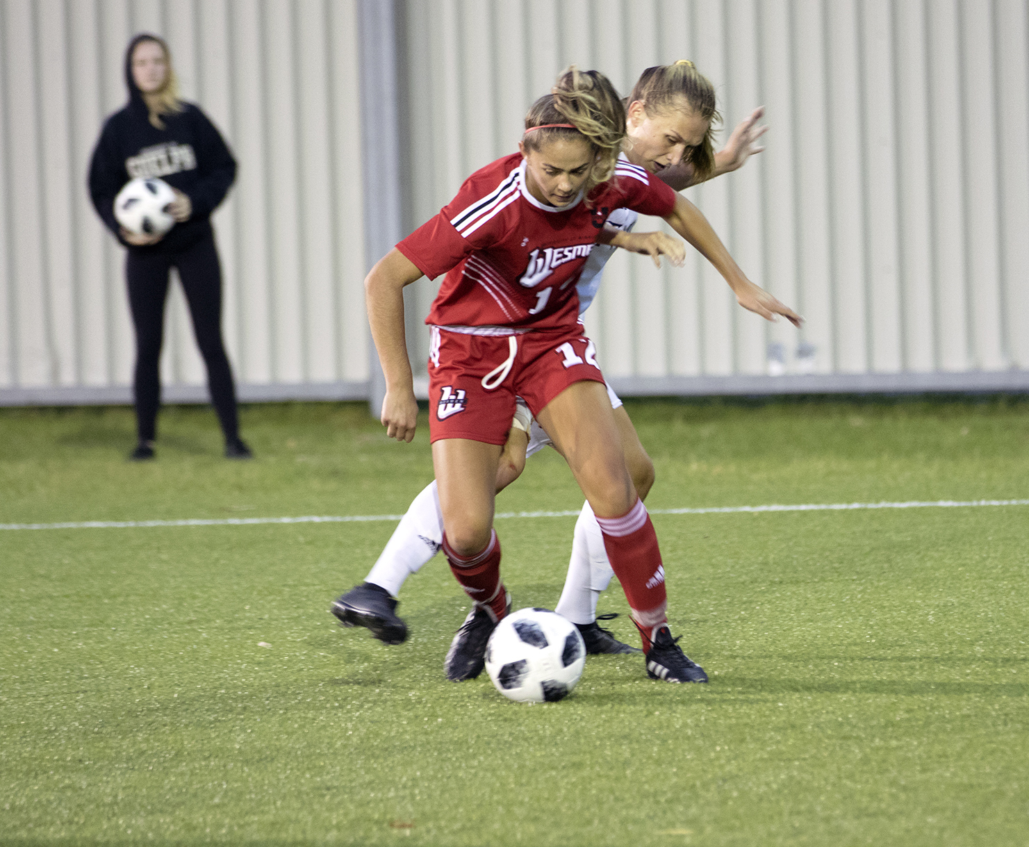 Wesmen forward Shae-Lynn Dodds fights off a Trinity Western opponent during a 3-0 loss Saturday night. (David Larkins/Wesmen Athletics)
