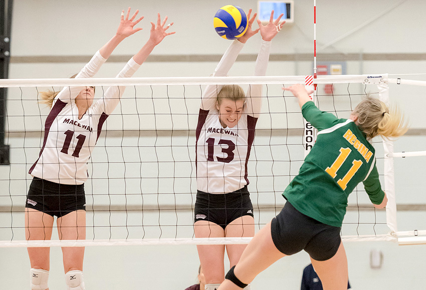Cassidy Kinsella (13) and McKenna Stevenson (11) block Regina's Haley Wagar during a match last month. Against Calgary on Friday, Kinsella had 21 kills and 22.5 points to move into third on the Canada West career list in both categories (Chris Piggott photo).