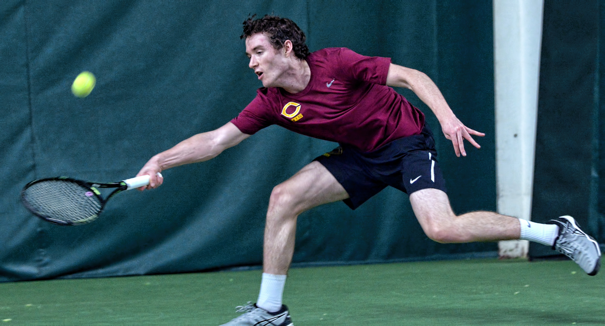 Sophomore Erik Porter stretches for a forehand. He cruised to a 6-1, 6-1 win at No.2 singles in the Cobbers' 5-4 win over St. Olaf.