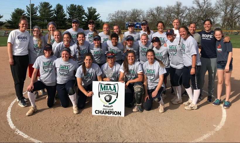 The Flying Dutch softball team poses together after winning the MIAA Tournament