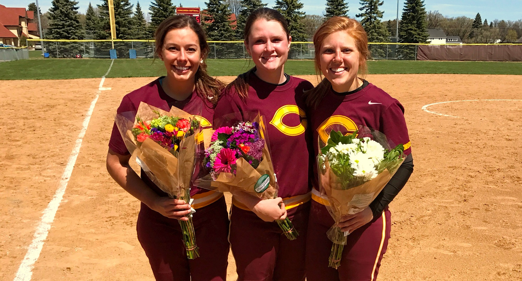 Cobber seniors (L-R) Maddie Little, Gabby Gardner and Taylor Rasmussen combined to go 5-for-10 and drive in three runs in CC's 5-1 win over SMU in Game 1.