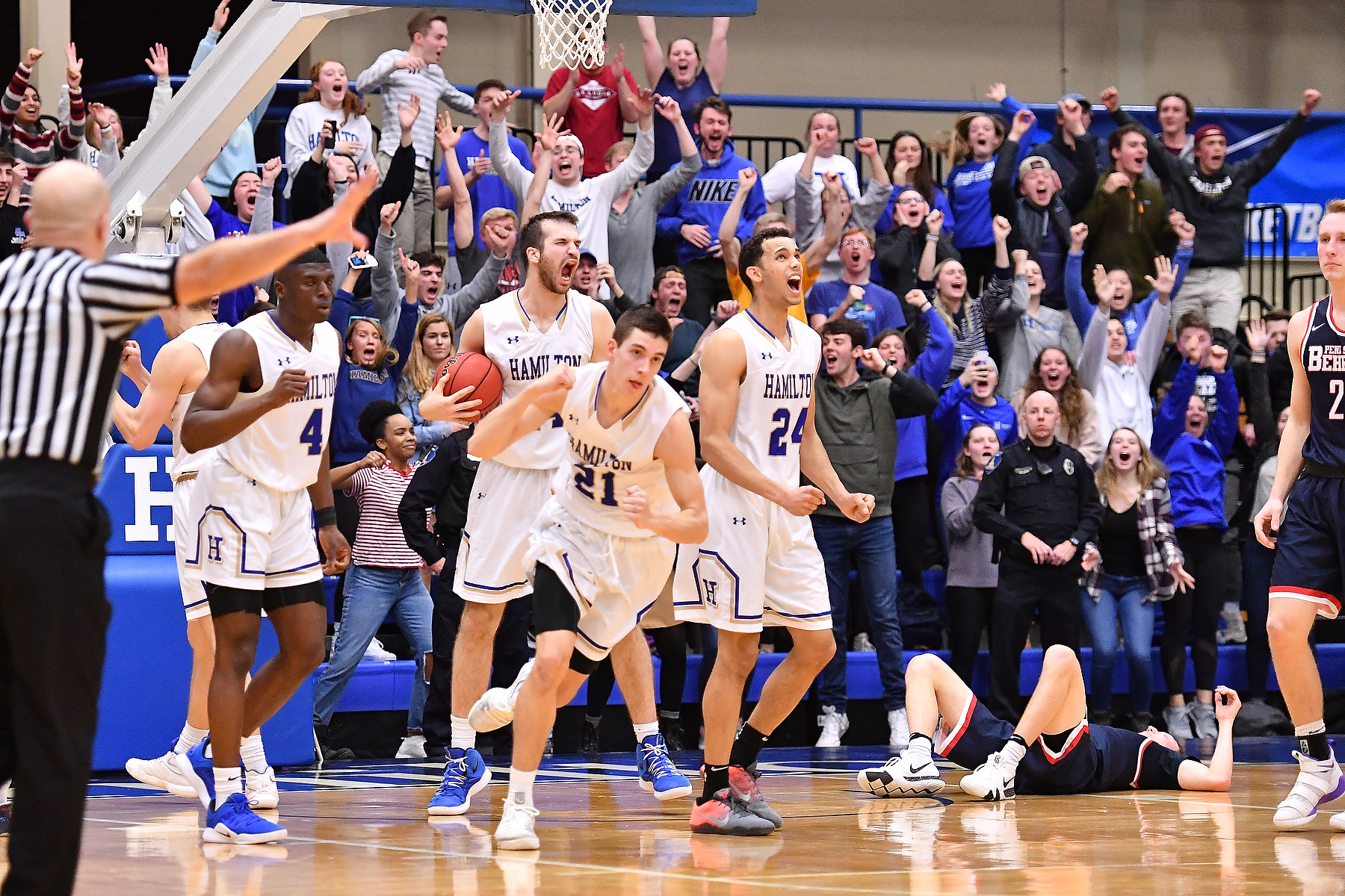 Nick Osarenren '22, Andrew Groll '19, Spencer Kendall '21 and Kena Gilmour '20 (left to right) celebrate the Continentals' 72-70 win over Penn State Behrend in the first round of the 2019 NCAA Division III Men's Basketball Championship on Friday night at Hamilton (Josh McKee photo).