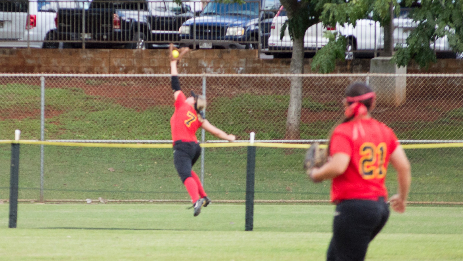 Katie Didonna robs a home run in the first game against Concordia.