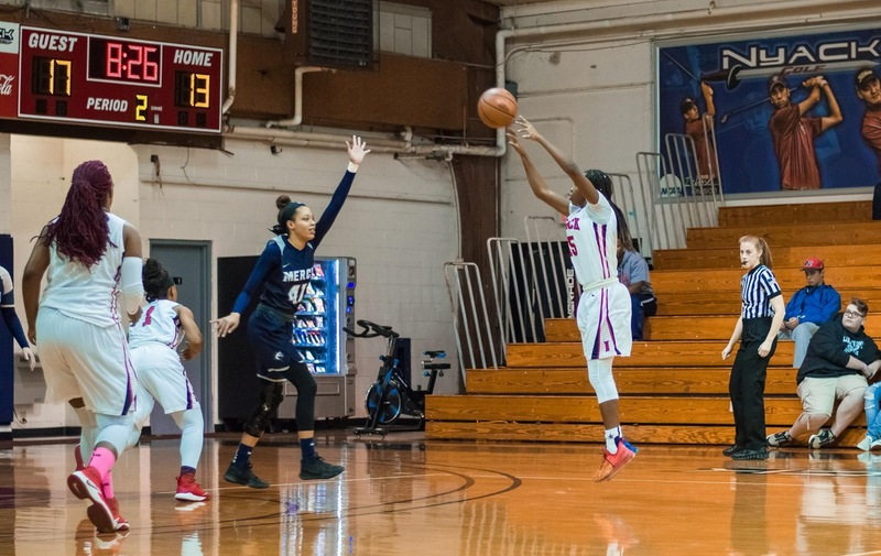 Women's Basketball Upended by Post Eagles in Division Match