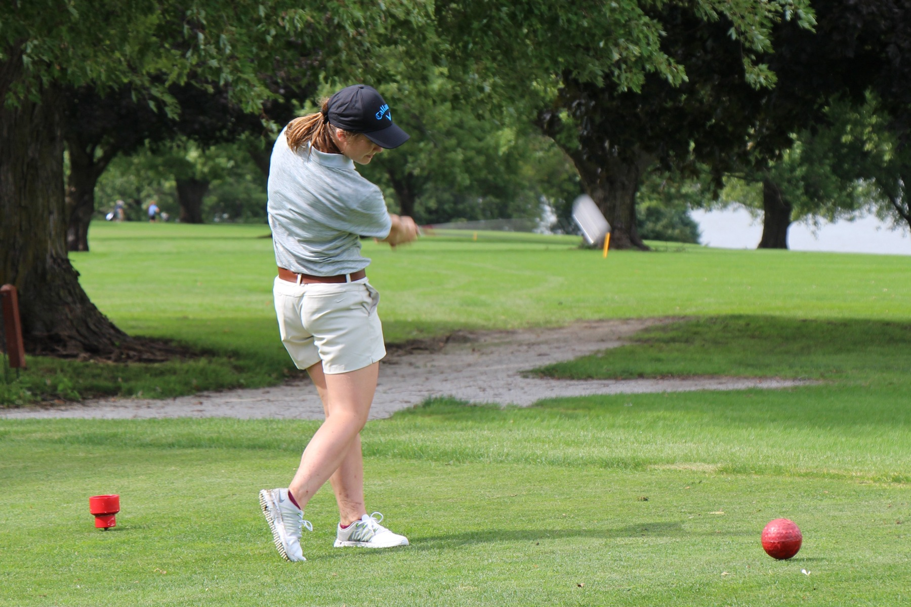 Freshman from Lenox, Iowa, Katelyn Belding teeing off for the Spartans.