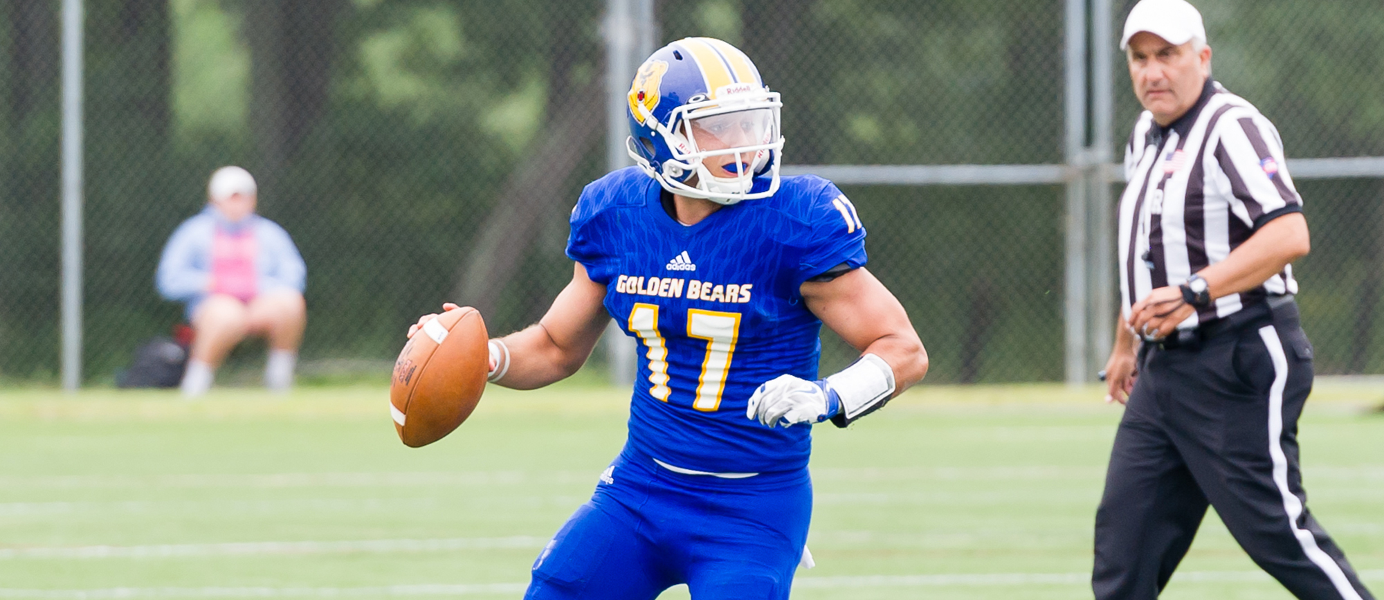 Junior quarterback Alec Coleman accounted for 285 yards of total offense and six touchdowns as the Golden Bears rolled past UNE 70-13 during Saturday's homecoming festivities. (Photo by Bryan Hewitt)