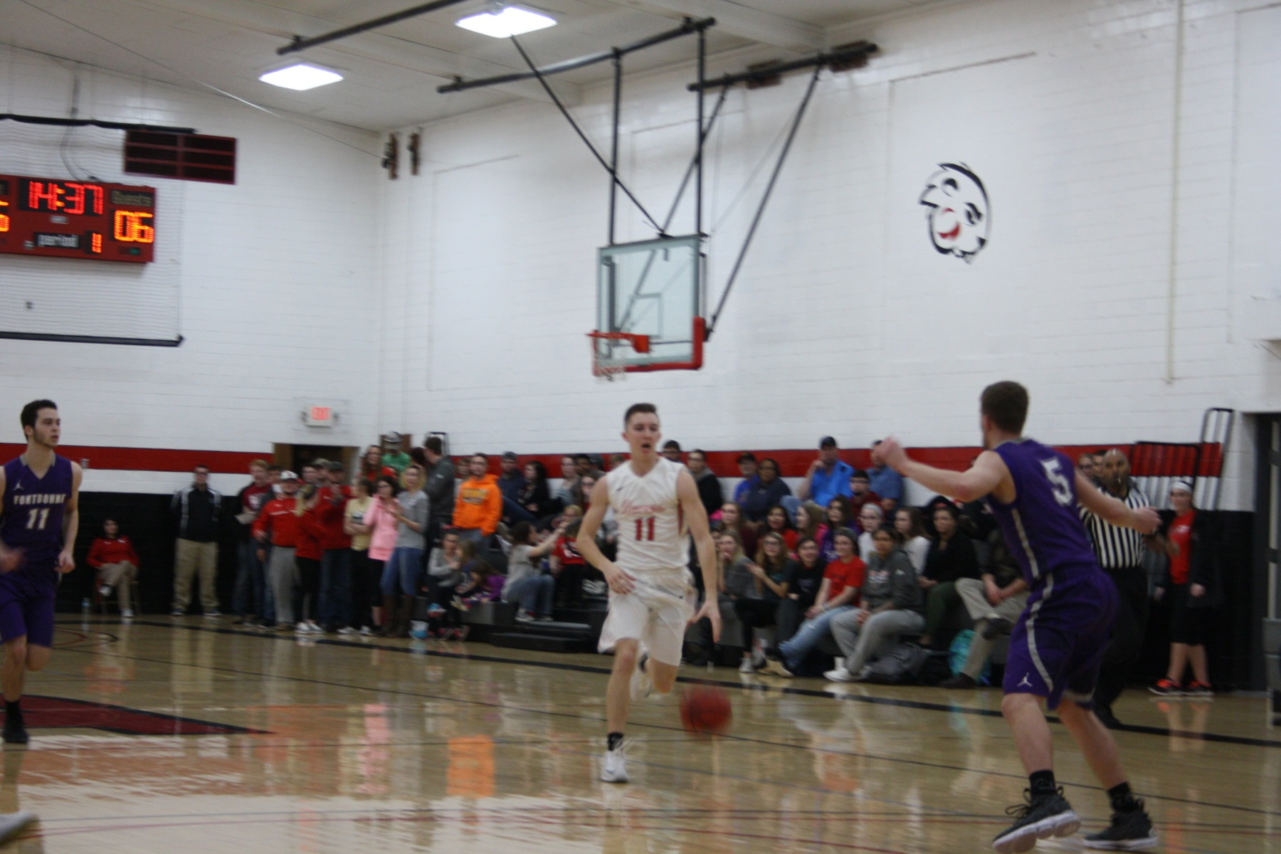 Reed Rusten brings the ball up the floor for the Beavers.