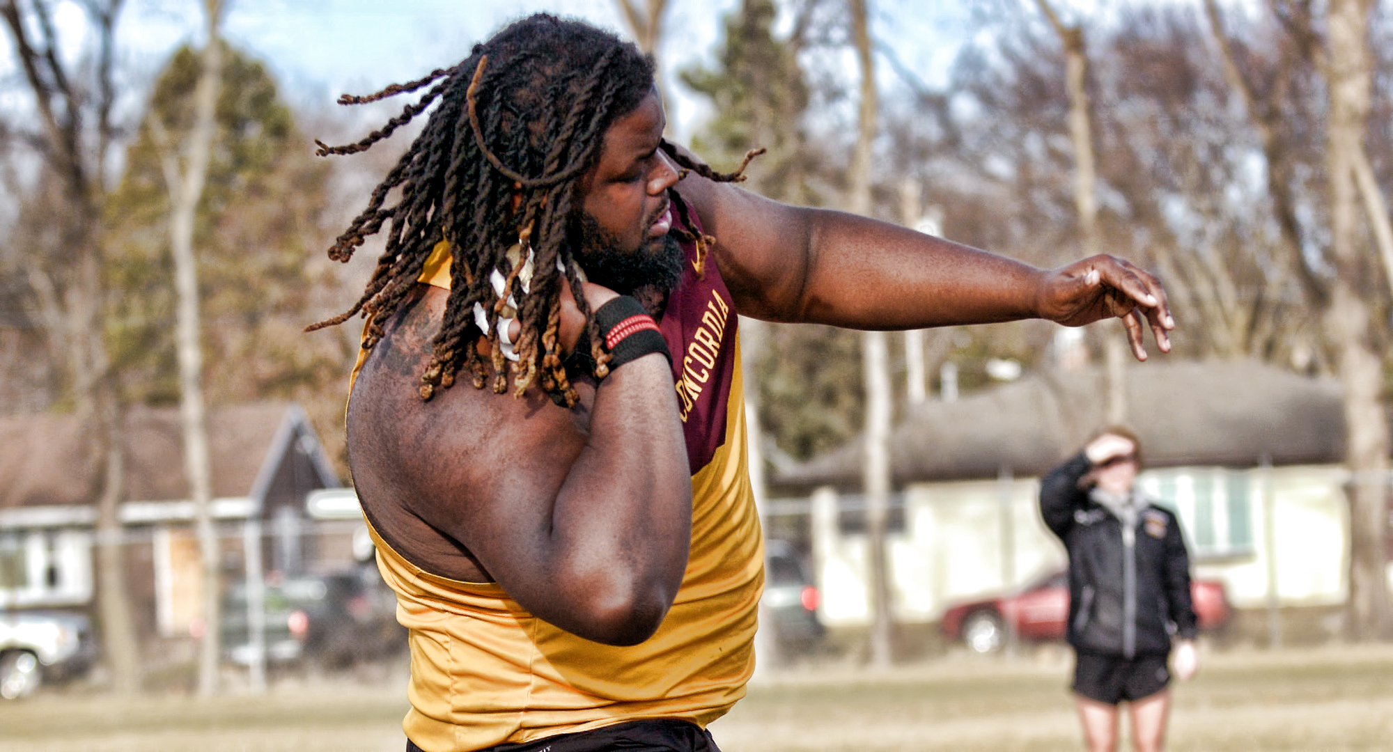 Senior Adam Frazier gets ready to unleash the winning throw in the shot put at the Cobber Twilight Meet.