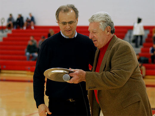 Dick Voith '77 (left) is presented his MAC Hall of Fame award by his coach Tony Zanin.