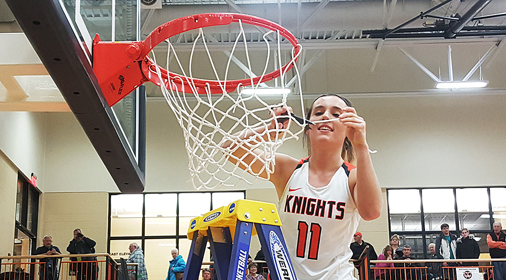 Katie Sommer cuts the net for Wartburg