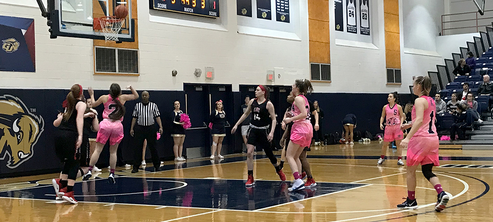 Gallaudet and Lancaster Bible meet on Padden Court in the Field House for a women's basketball game. GU is wearing special pink uniforms.