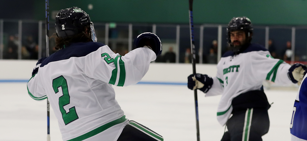 Thomas Daniels celebrates a goal with teammate Ryan Dougherty.