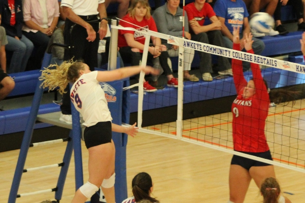 Jessica Hopkins hammers a kill through the defense in the third set of their 3-0 victory over the Spartans.