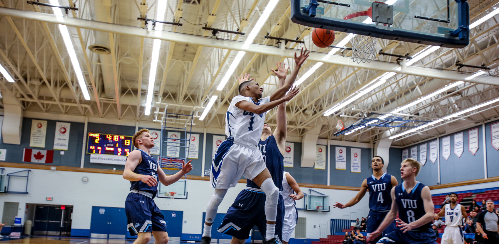 Point guard Brenden Bailey drives hard to the hoop against VIU. Photo Paul Yates / Vancouver Sports Pictures