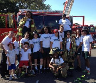 The Felician women's basketball team poses at the 10th Annual Rutherford Touch-A-Truck on Sept. 28, 2014.