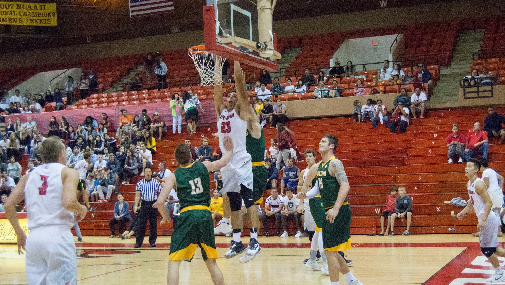 Caeleb Roney dunks a ball in the first half against Point Loma.