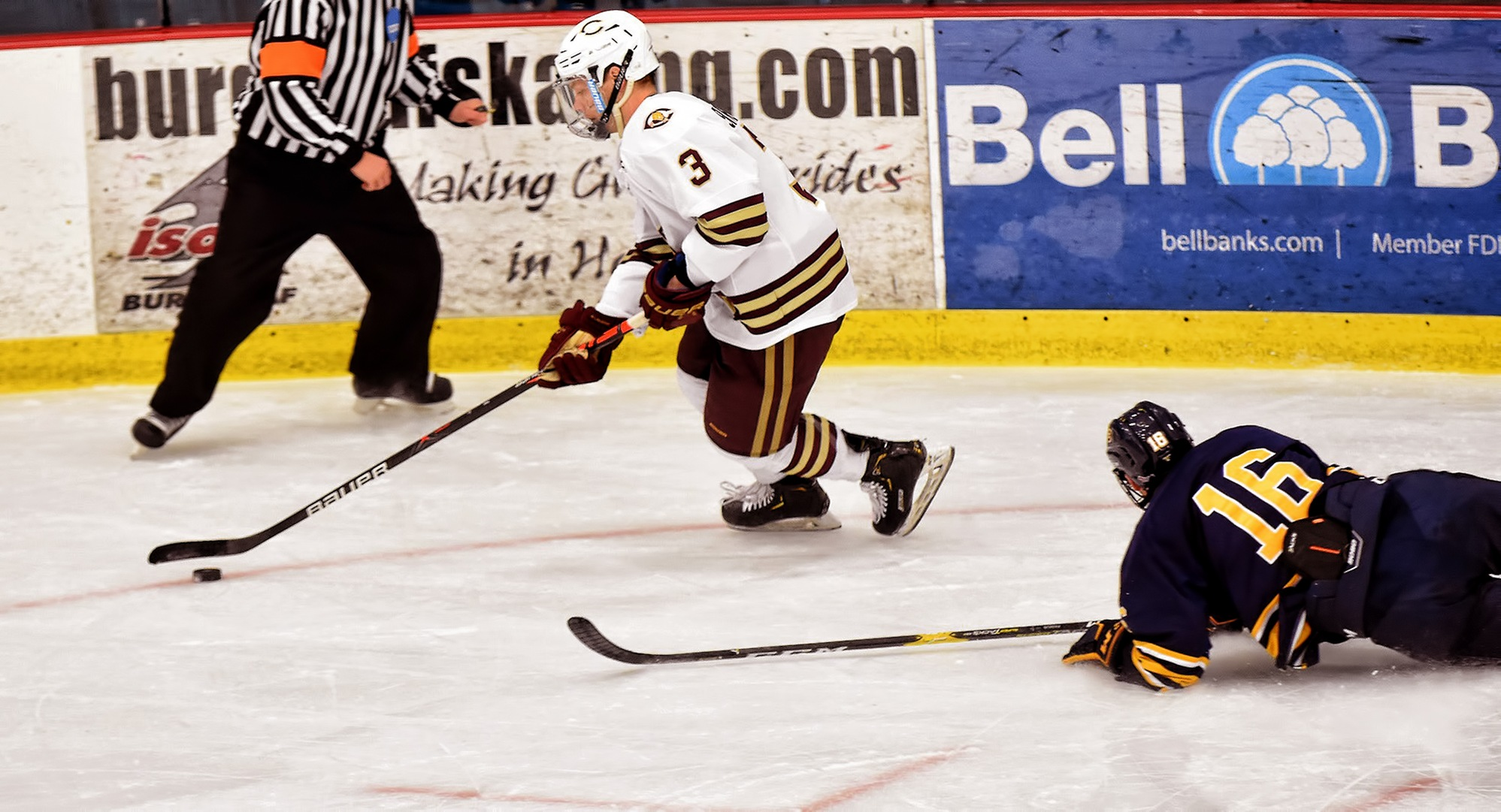 Junior Kyle Siemers eludes a Wis.-Eau Claire defender during the second period of the Cobbers' game with the Blugolds. Siermers scored both goals for the Cobbers.