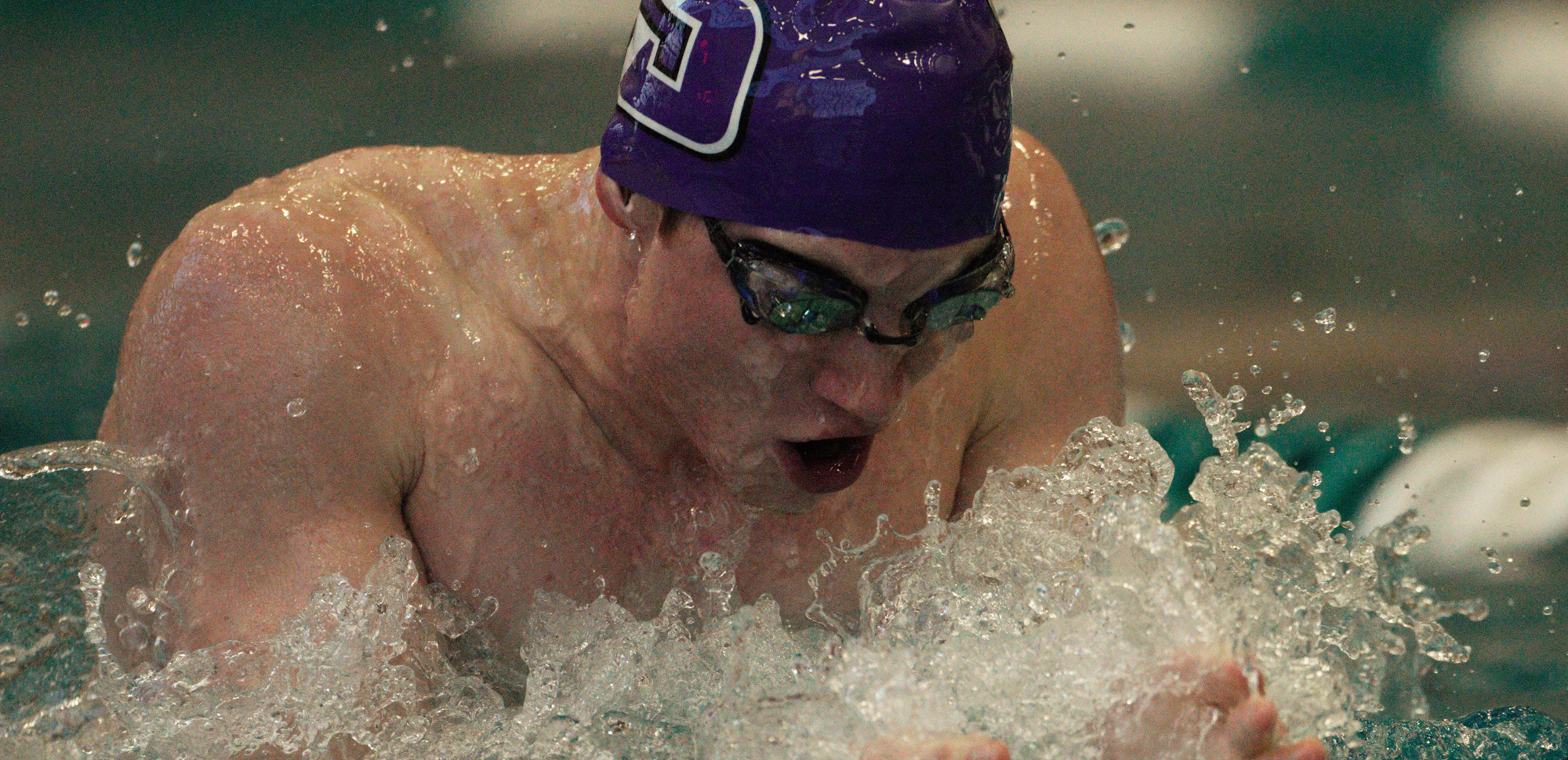 Patrick Blaser won the 100 breaststroke after helping the Royals set a pool record in the 200 medley relay.