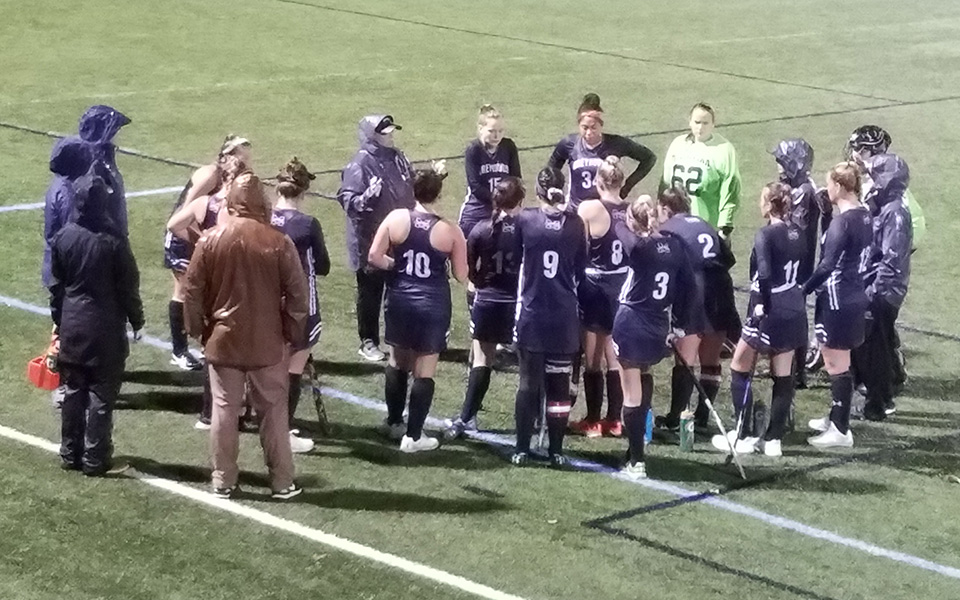 The Greyhounds talk between the first and second quarter of a rainy match versus Elizabethtown College on John Makuvek Field.