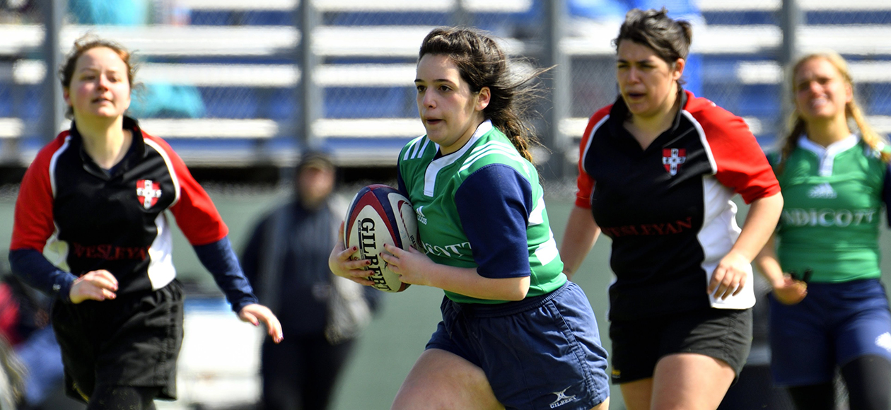 A women's rugby student-athlete runs.