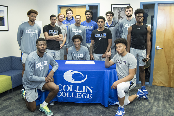 Nighael Ceaser is surrounded by teammates on signing day. Photo by KIRK DICKEY