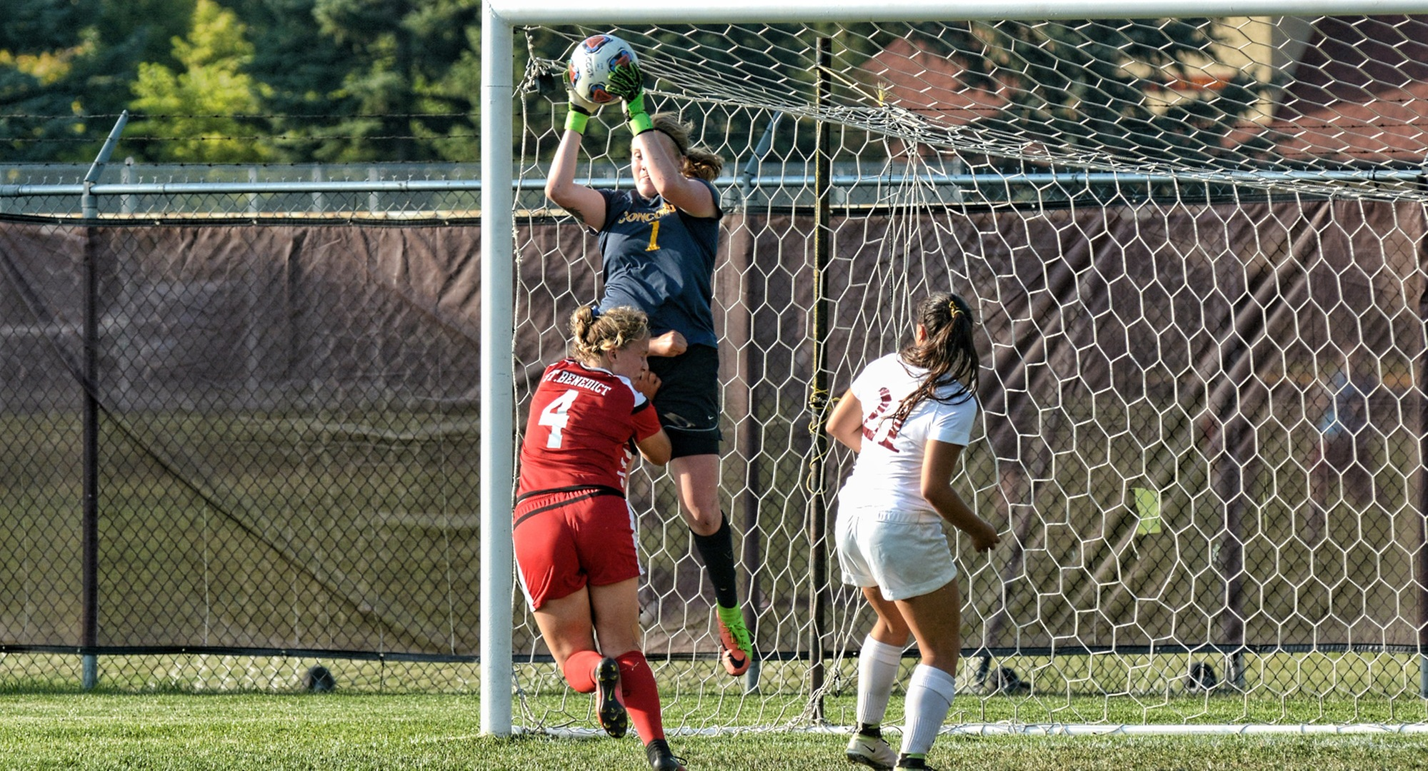 Concordia junior goalie Maddy Reed rises above the competition as she snares a crossing attempt during the Cobbers' MIAC opener with St. Ben's.