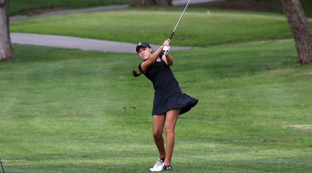 Emily Lewis hits from the fairway.