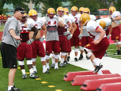 FSU Defensive Coordinator Duane Wilson works a group out during preseason practice last year (Photo by Sandy Gholston)
