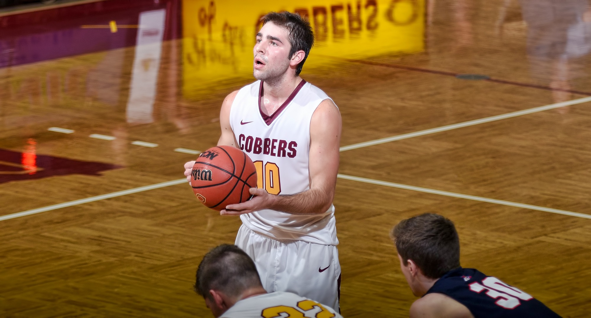 Senior Tommy Schyma gets ready to drain a free throw during the second half of the Cobbers' Senior Celebration Day against St. Mary's. Schyma finished with 25 points and 10 rebounds in his first game back since Dec. 14.