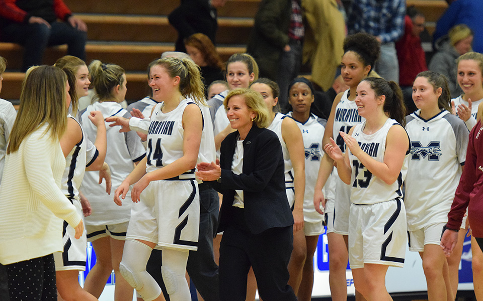 Head Coach Mary Beth Spirk and the Greyhounds are all smiles after the Hounds rallied from a 13-point deficit to defeat Muhlenberg College in Johnston Hall and give SPirk her 600th career win.