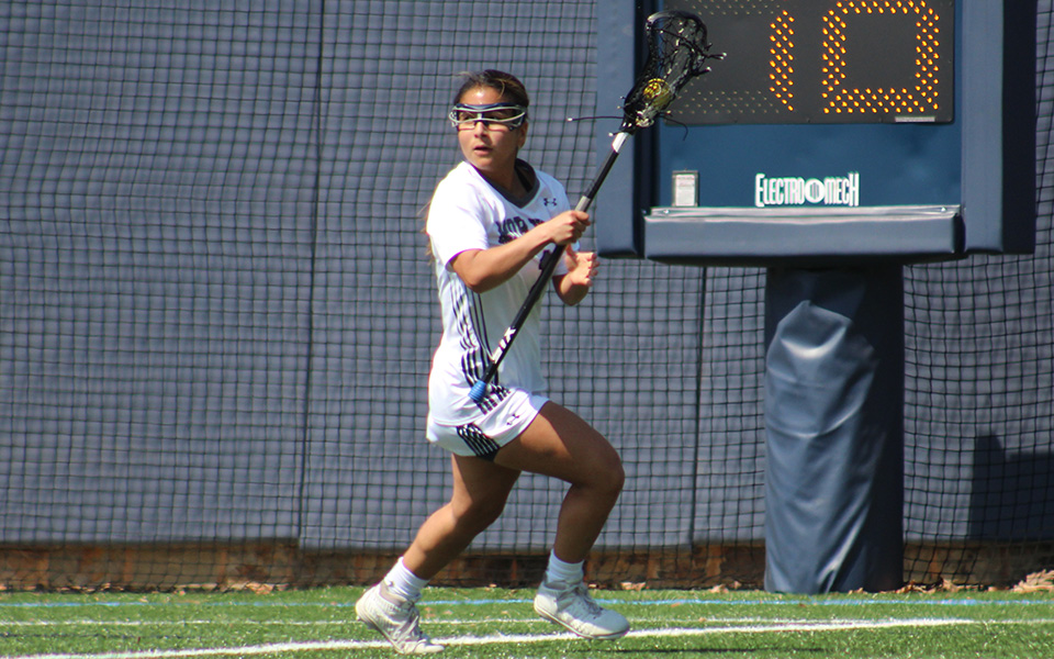 Senior Dalia Aguilar looks to pass in a match versus Susquehanna University on John Makuvek Field.