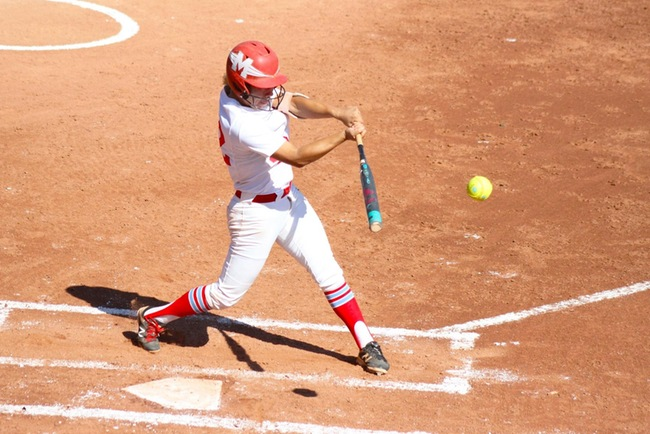 Valerie Macias rips a triple with the bases loaded against South Mountain in game one. (photo by Aaron Webster)