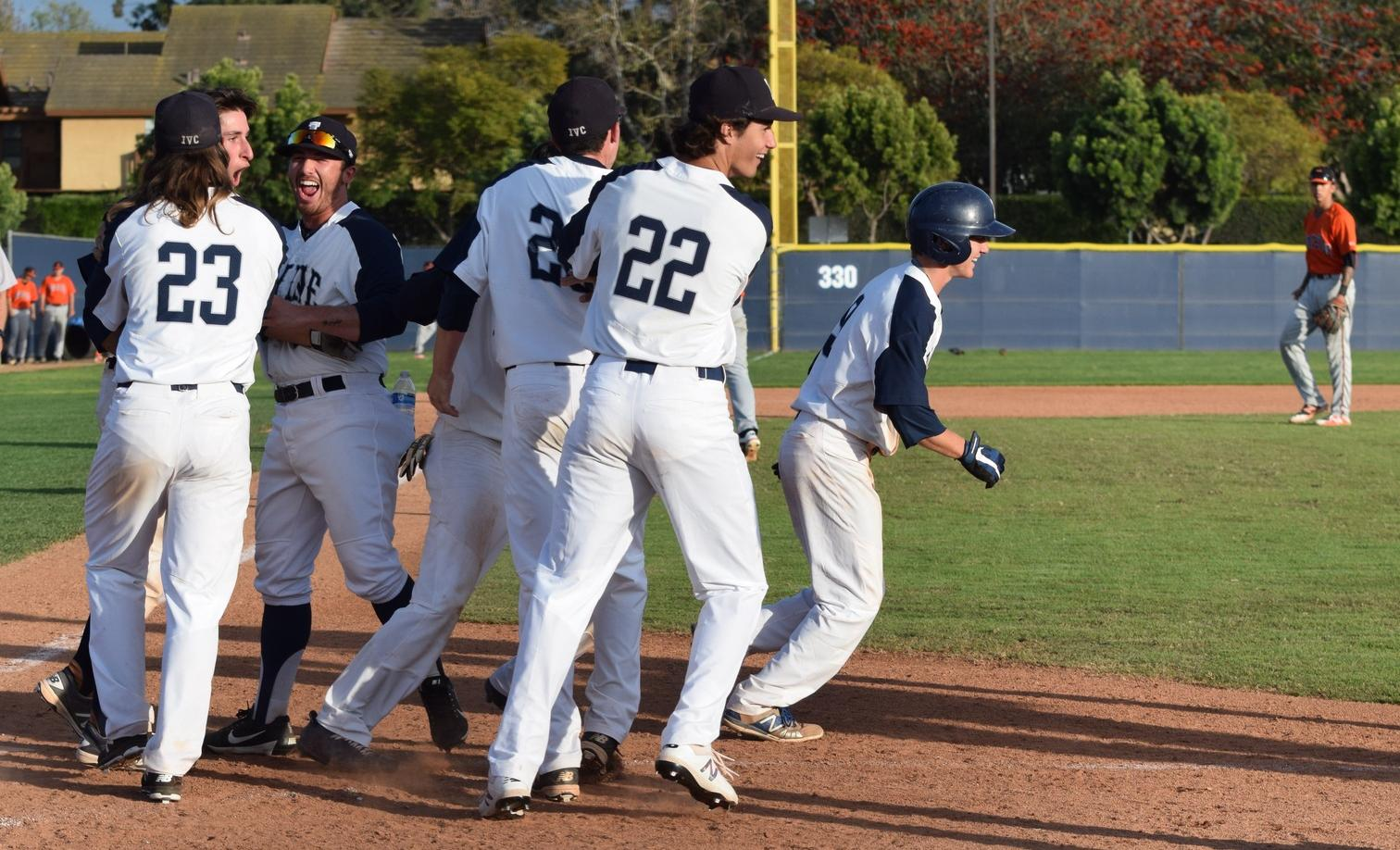 Baseball team wins on McGinnis' bases loaded walk in ninth