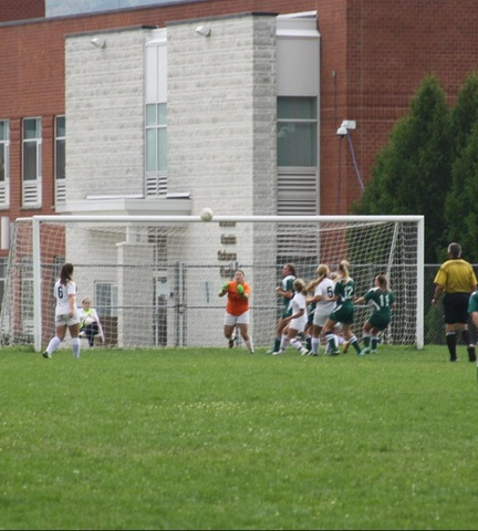 SUNY Broome goalkeeper getting ready to make save against Herkimer College