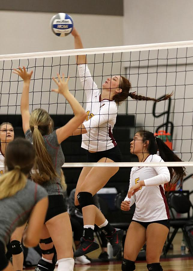 Danielle Johnson pounds a kill with setter Emily Leung looking on during PCC's season opener at the Pierce 3rd Kickoff Classic Friday, photo by Richard Quinton.