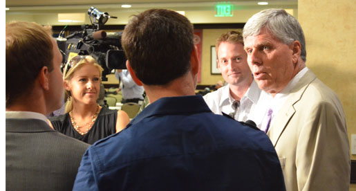 Golden Eagle coach Watson Brown meets with television reporters at OVC Media Day