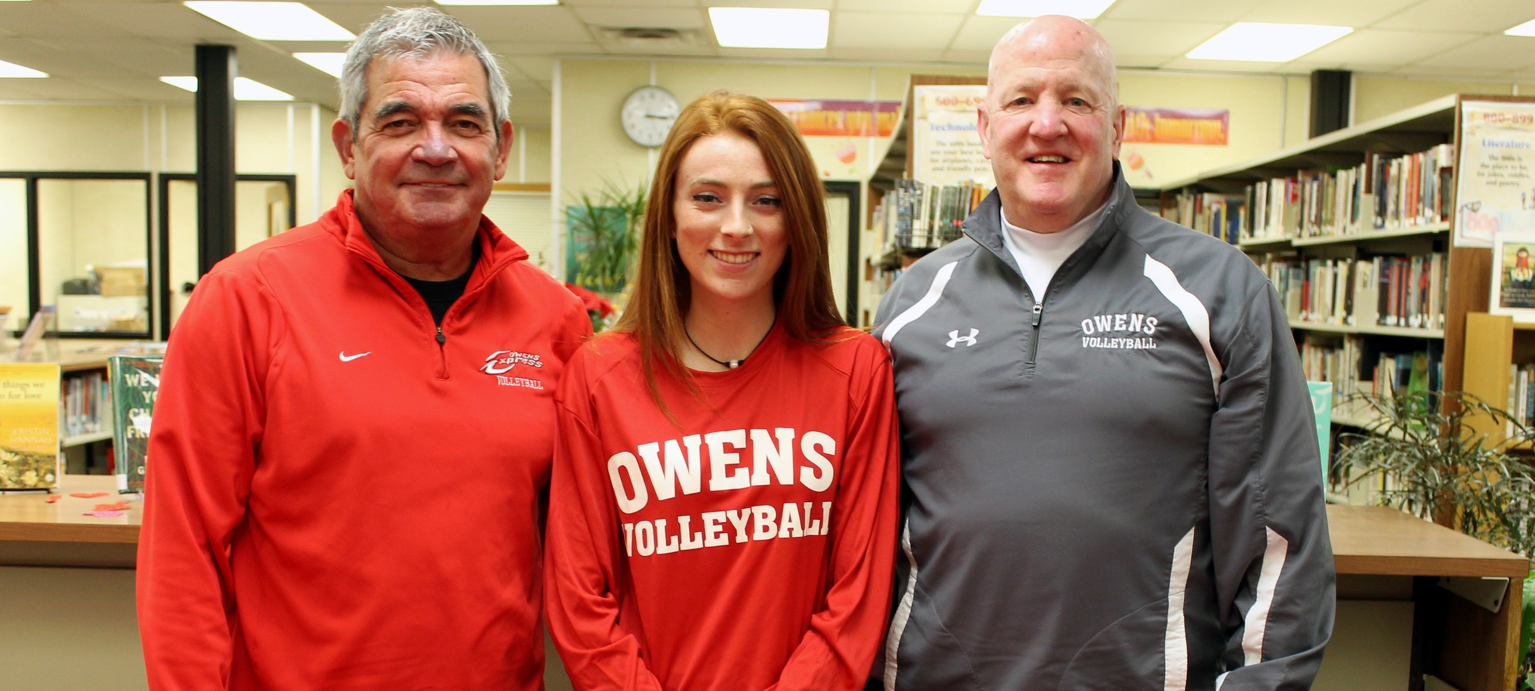 Kennedy Ames is pictured with Owens volleyball head coach Sonny Lewis (L) and assistant coach Denny Caldwell (R). Photo by Nicholas Huenefeld/Owens Sports Information
