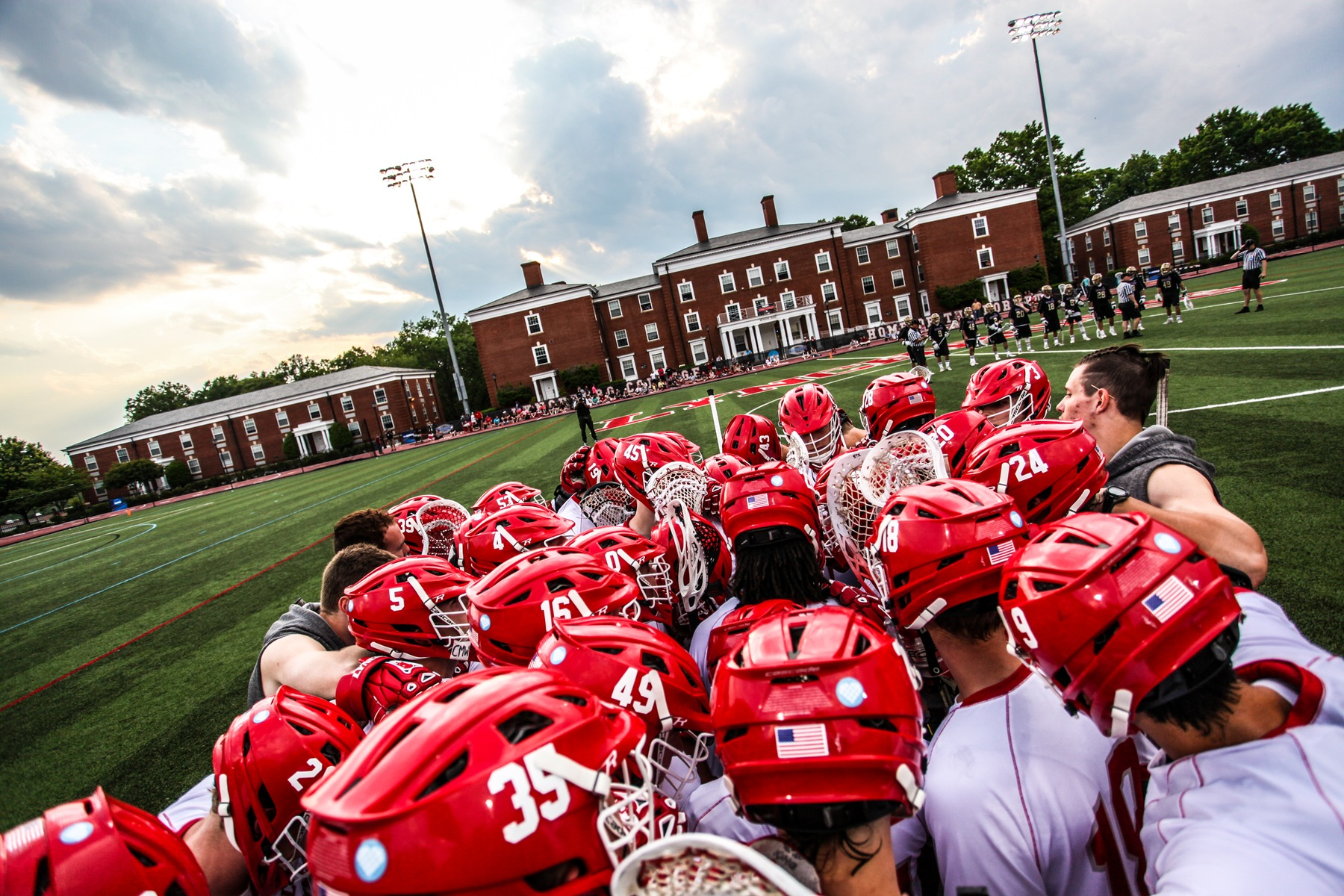 Lynchburg men's lacrosse huddles on the field before a game.