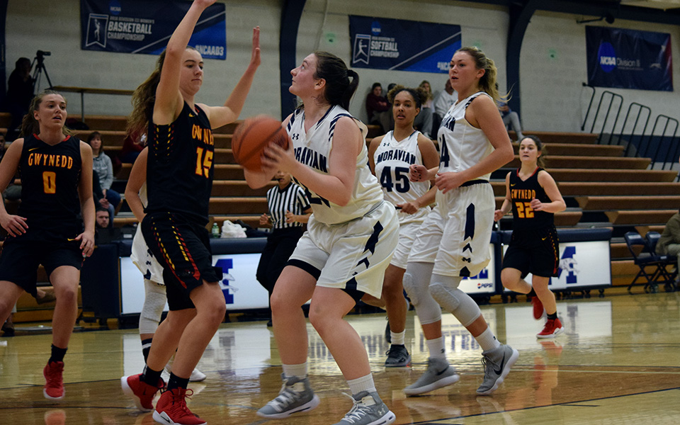 Sophomore Jennifer McClave goes up for a lay-up versus Gwynedd Mercy University in Johnston Hall.