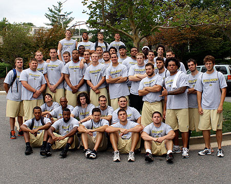 GU football players help welcome and move-in new students
