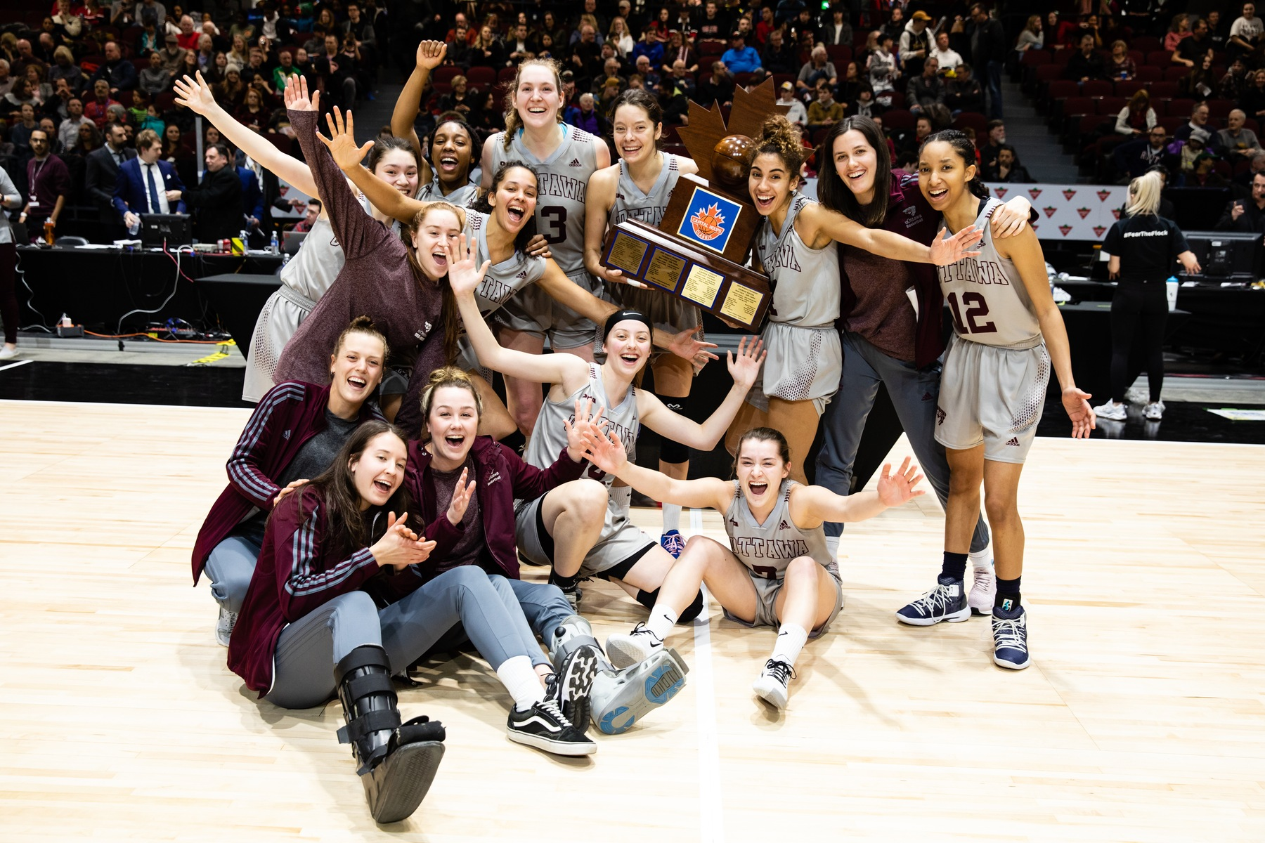 Gee-Gees women's team 2020 celebrates with trophy
