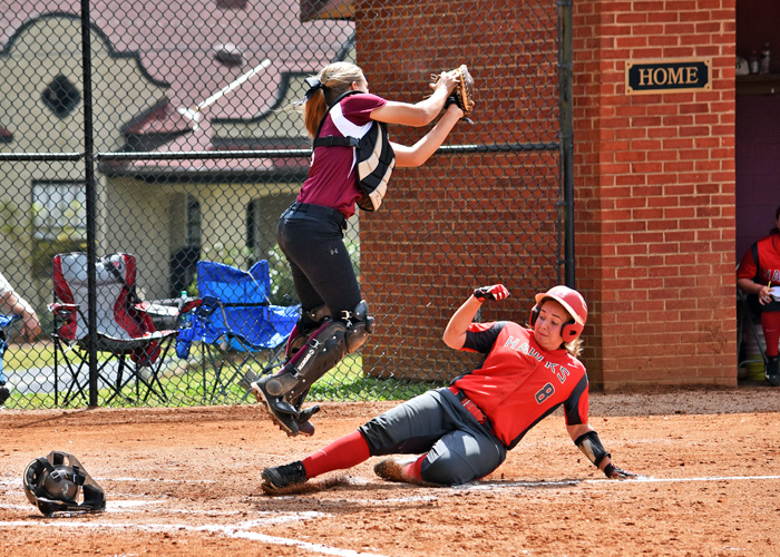 Brandi Blair slides in safely at home in Game 1 of Saturday's doubleheader with Meredith.