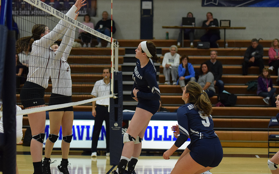 Erin Tiger sends an attack across the net versus Muhlenberg College.