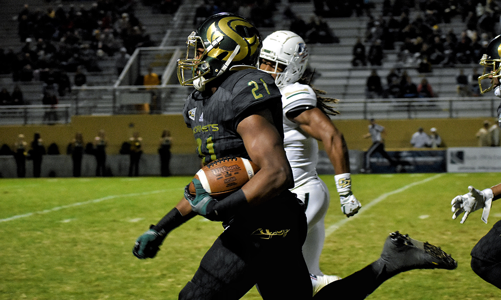 FOOTBALL BLOWS PAST CAL POLY, 49-14, GUARANTEES WINNING RECORD